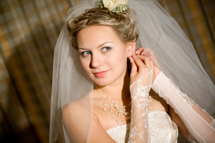 a bride playes with her dress